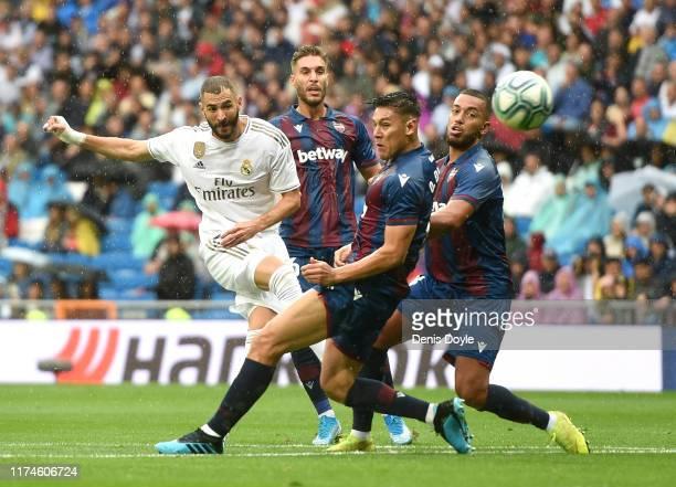 Karim Benzema of Real Madrid shoots on goal during the La Liga match between Real Madrid CF and Levante UD at Estadio Santiago Bernabeu on September...