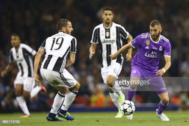 Karim Benzema of Real Madrid vies Bonucci of Juventus during the UEFA Champions League Final between Juventus and Real Madrid at National Stadium of...