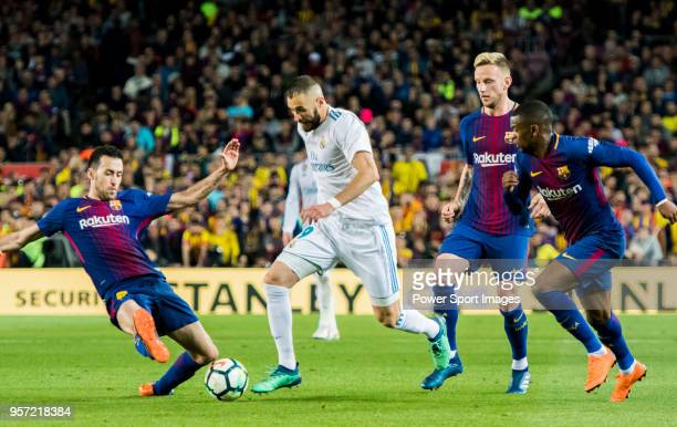 Karim Benzema of Real Madrid vies for the ball with Sergio Busquets Burgos of FC Barcelona during the La Liga match between Barcelona and Real Madrid...