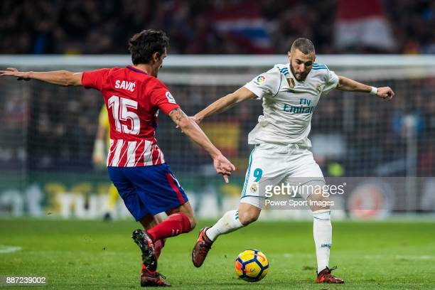 Karim Benzema of Real Madrid vies for the ball with Stefan Savic of Atletico de Madrid during the La Liga 201718 match between Atletico de Madrid and...