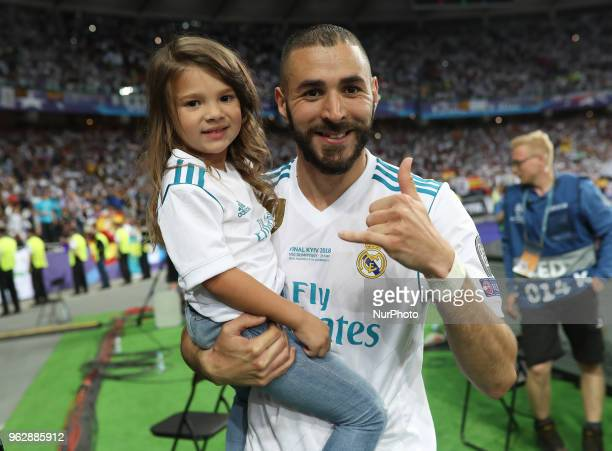 Karim Benzema of Real Madrid with his doughter celebrate winning the UEFA Champions League final between Real Madrid and Liverpool at NSC Olimpiyskiy...