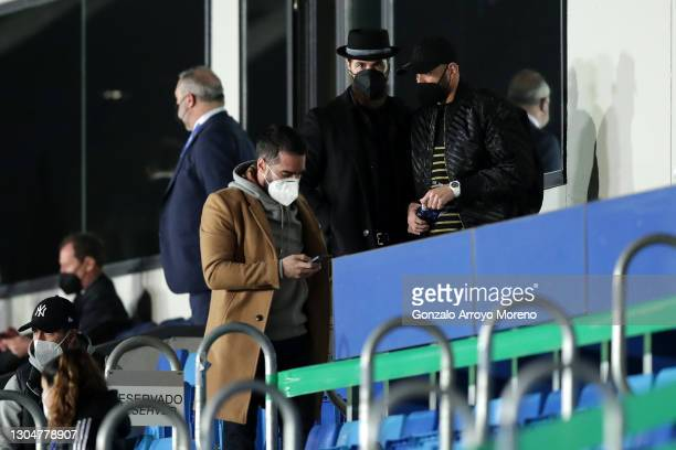 Karim Benzema, Sergio Ramos and Dani Carvajal of Real Madrid watch on from the stands during the La Liga Santander match between Real Madrid and Real...