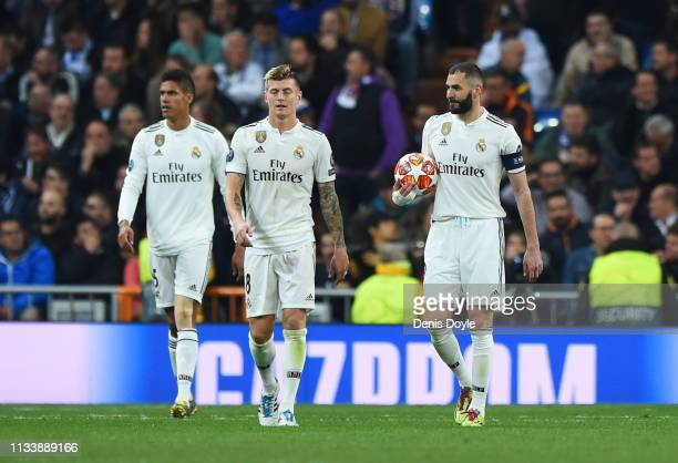 Karim Benzema Toni Kroos and Raphael Verane of Real Madrid look dejected during the UEFA Champions League Round of 16 Second Leg match between Real...