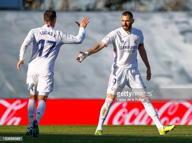 Karim Benzema with Lucas Vázquez from Real Madrid CF during the La Liga Santander match between Real Madrid and Elche CF at Estadio Alfredo Di...