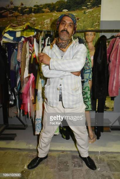 Karim Bonnet fashion designer from Impasse De La Defense pose with his dresses collection Harvey Ambomo BDay Party at 15 Rue Polonceau on October 26,...
