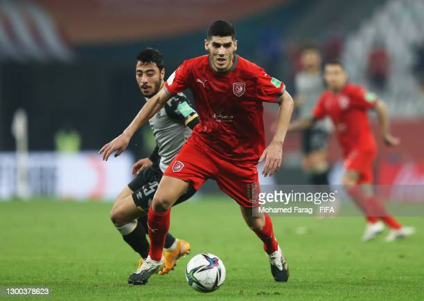 Karim Boudiaf of Al Duhail SC runs with the ball under pressure from Akram Tawfik of Al Ahly SC during the FIFA Club World Cup Qatar 2020 Second...