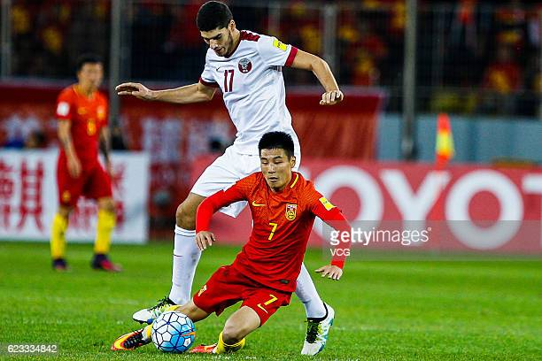 Karim Boudiaf of Qatar and Wu Lei of China vie for the ball during the 2018 FIFA World Cup Qualifier match between China and Qatar at Tuodong Stadium...