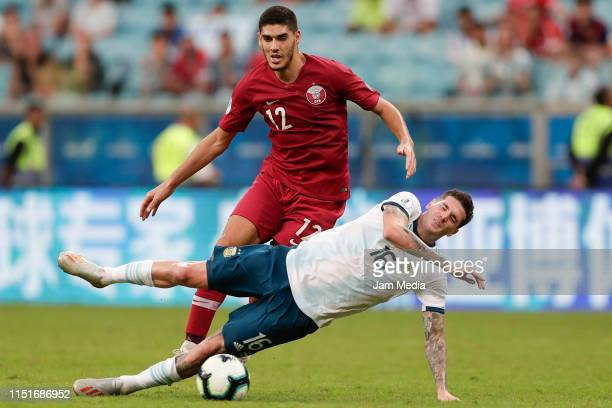 Karim Boudiaf of Qatar fights for the ball with Rodrigo De Paul of Argentina during the Copa America Brazil 2019 group B match between Qatar and...