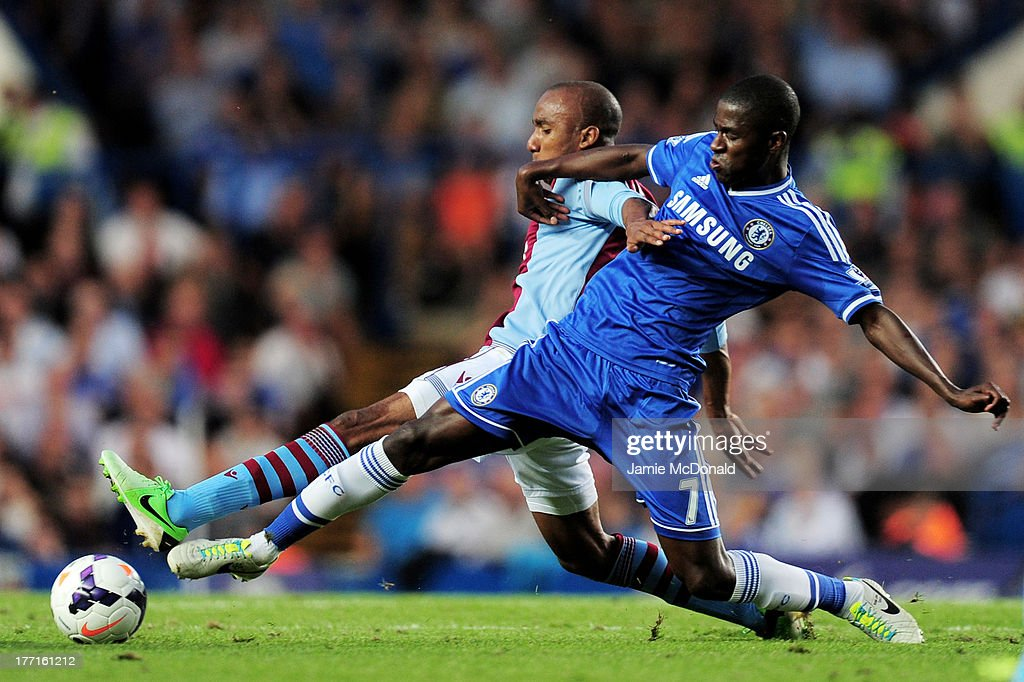 Karim El Ahmadi of Aston Villa and Ramires of Chelsea compete for the ball during the Barclays Premier League match between Chelsea and Aston Villa at Stamford Bridge on August 21, 2013 in London, England.