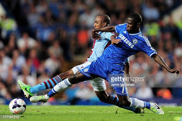 Karim El Ahmadi of Aston Villa and Ramires of Chelsea compete for the ball during the Barclays Premier League match between Chelsea and Aston Villa...