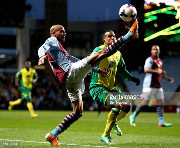 Karim El Ahmadi of Aston Villa controls the ball ahead of Martin Olsson of Norwich during the Barclays Premier League match between Aston Villa and...