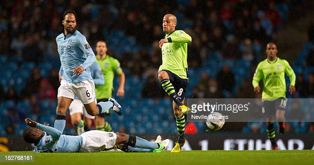 Karim El Ahmadi of Aston Villa is challenged by Abdul Razak of Manchester City of the game during the Capital One Cup match between Manchester City...