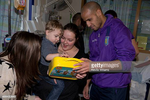 Karim El Ahmadi of Aston Villa meets patients during a visit to Birmingham Children's Hospital on December 11 2013 in Birmingham England