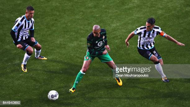 Karim El Ahmadi of Feyenoord battles for the ball with Joey Pelupessy and Kristoffer Peterson of Heracles Almelo during the Dutch Eredivisie match...