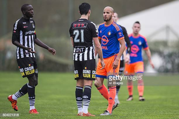 Karim El Ahmadi of Feyenoord is having a discussion with Jeremy Perbet of Sporting de Charleroi during the International friendly match between...