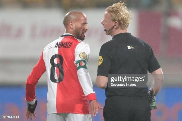 Karim El Ahmadi of Feyenoord Referee Kevin Blom during the Dutch Eredivisie match between Roda JC v Feyenoord at the Parkstad Limburg Stadium on...