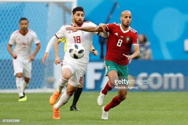 Karim El Ahmadi of Morocco in action against Alireza Jahanbakhsh of IR Iran during the 2018 FIFA World Cup Russia Group B match between Morocco and...