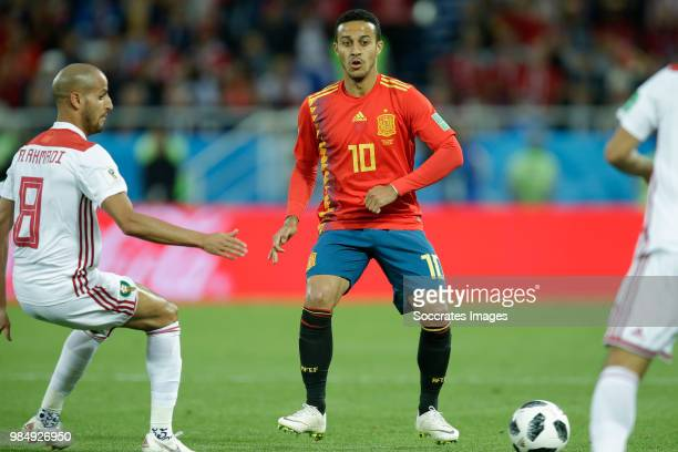 Karim El Ahmadi of Morocco Thiago of Spain during the World Cup match between Spain v Morocco at the Kaliningrad Stadium on June 25 2018 in...