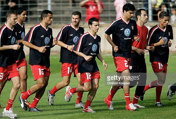 Karim Essediri Jawhar Mnari Adel Chadli Slim Benachour Karim Saidi goalkeeper Khaled Fadhel and Anis Ayari run during the Tunisian National Team...