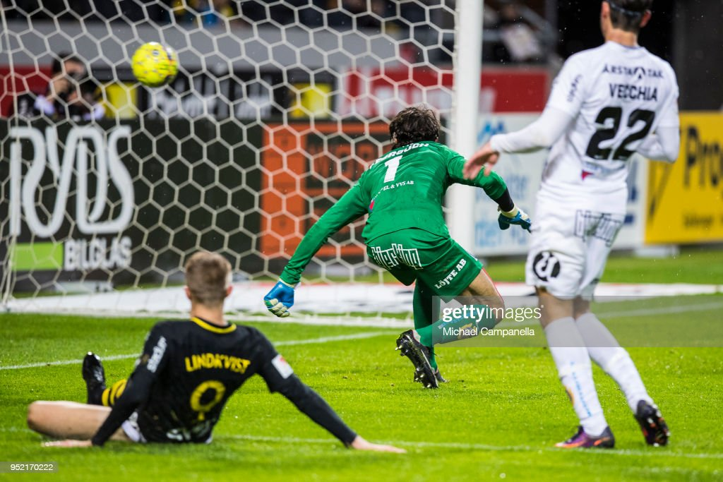 Karim Fegrouch goalkeeper of IK Sirius fails to stop the shot from Nabil Bahoui (not pictured) during an Allsvenskan match between AIK and IK Sirius at Friends Arena on April 27, 2018 in Solna, Sweden.