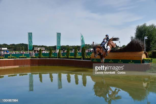 Karim Florent Laghouag of France riding Punch de l'Esques during the obstacle in the water of the Cross Country test DHLPrize in the park of the CHIO...
