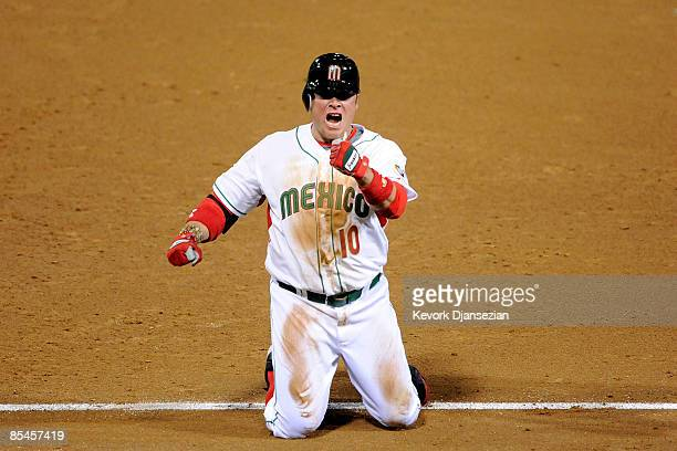 Karim Garcia of Mexico celebrates with the crowd after sliding safely into first base against Cuba during the 2009 World Baseball Classic Round 2...