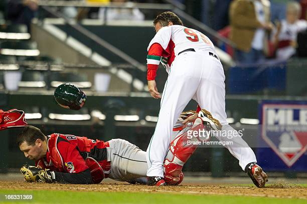 Karim Garcia of Mexico collides with Chris Robinson of Canada at home plate during the World Baseball Classic First Round Group D game on March 9...