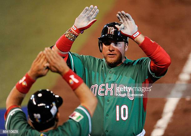 Karim Garcia of Mexico is congratulated after hitting a onerun home run against Cuba during the 2009 World Baseball Classic Pool B match on March 12...