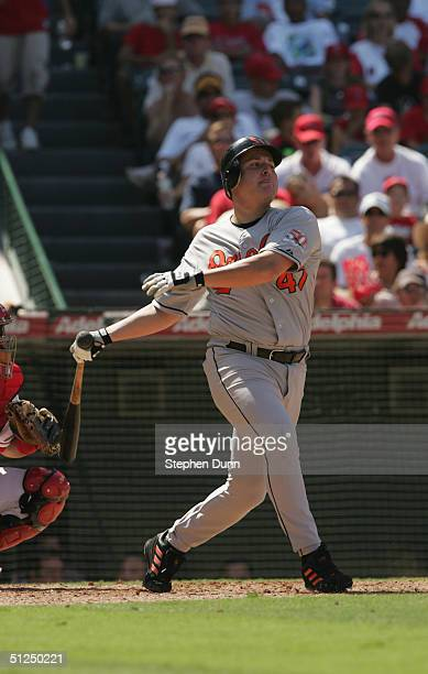 Karim Garcia of the Baltimore Orioles swings at the pitch during the game against the Anaheim Angels on August 12 2004 at Angel Stadium in Anaheim...