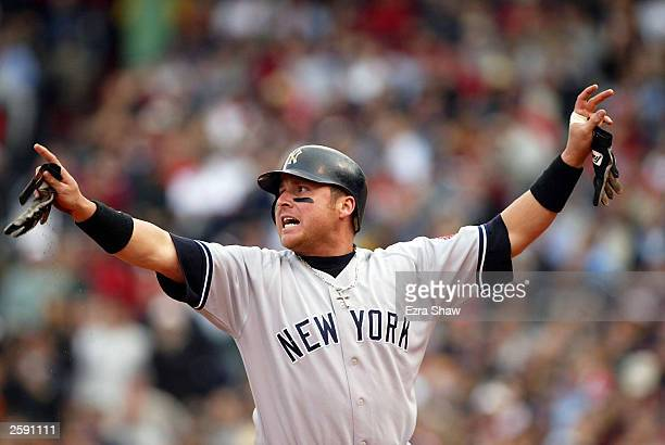Karim Garcia of the New York Yankees advances to third base off of a single hit by teammate Alfonso Soriano in the second inning of Game 5 of the...