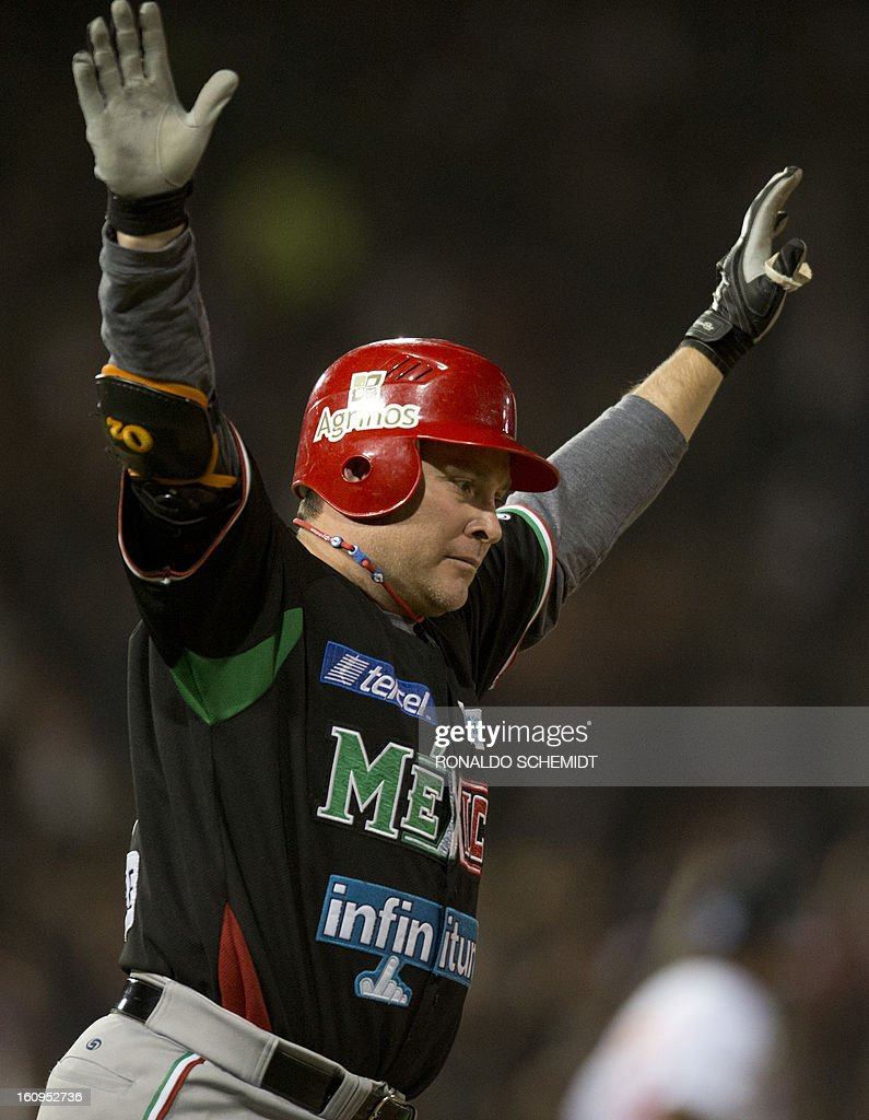 Karim Garcia of Yaquis de Obregon of Mexico celebrates his home run against Leones del Escogido of the Dominican Republic, during the final match of the 2013 Caribbean baseball series, on February 8, 2013, in Hermosillo, Sonora State, in northern of Mexico. Mexico won 4-3. AFP PHOTO/Ronaldo Schemidt