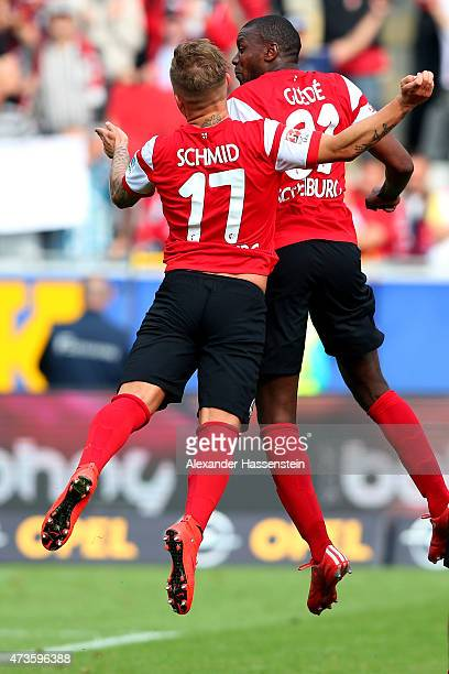 Karim Guede of Freiburg celebrates victory with his team mate Jonathan Schmid after winning the Bundesliga match between Sport Club Freiburg and FC...