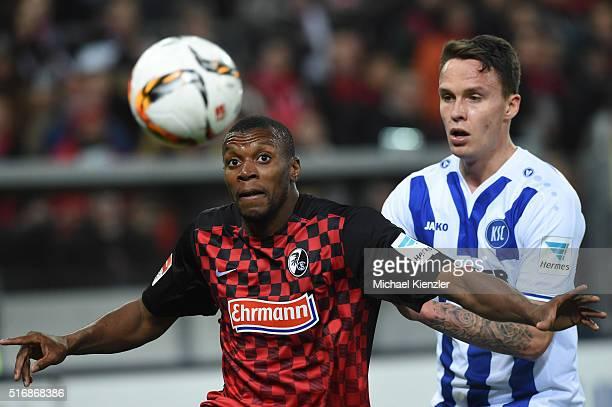 Karim Guede of SC Freiburg challenges Bjarne Thoelke of Karlsruher SC during the Bundesliga match between Sport Club Freiburg and Karlsruher SC at...