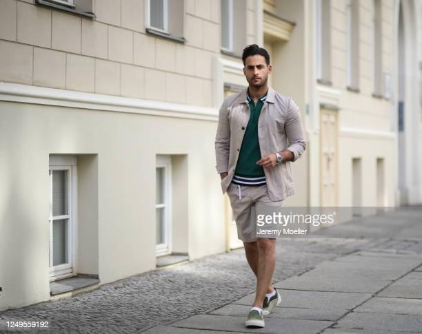 Karim Guenes wearing Asos shirt, Diesel pants, Wrangler jacket and Jimmy Choo sneaker on June 10, 2020 in Berlin, Germany.