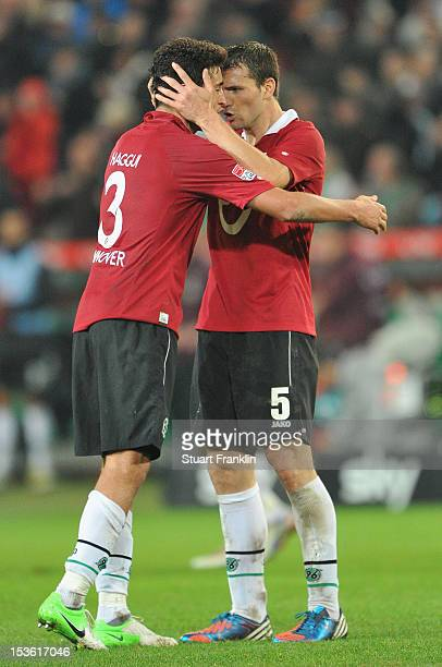 Karim Haggui and Mario Eggimann of Hannover celebrate during the Bundesliga match between Hannover 96 and Borussia Dortmund at AWD Arena on October 7...