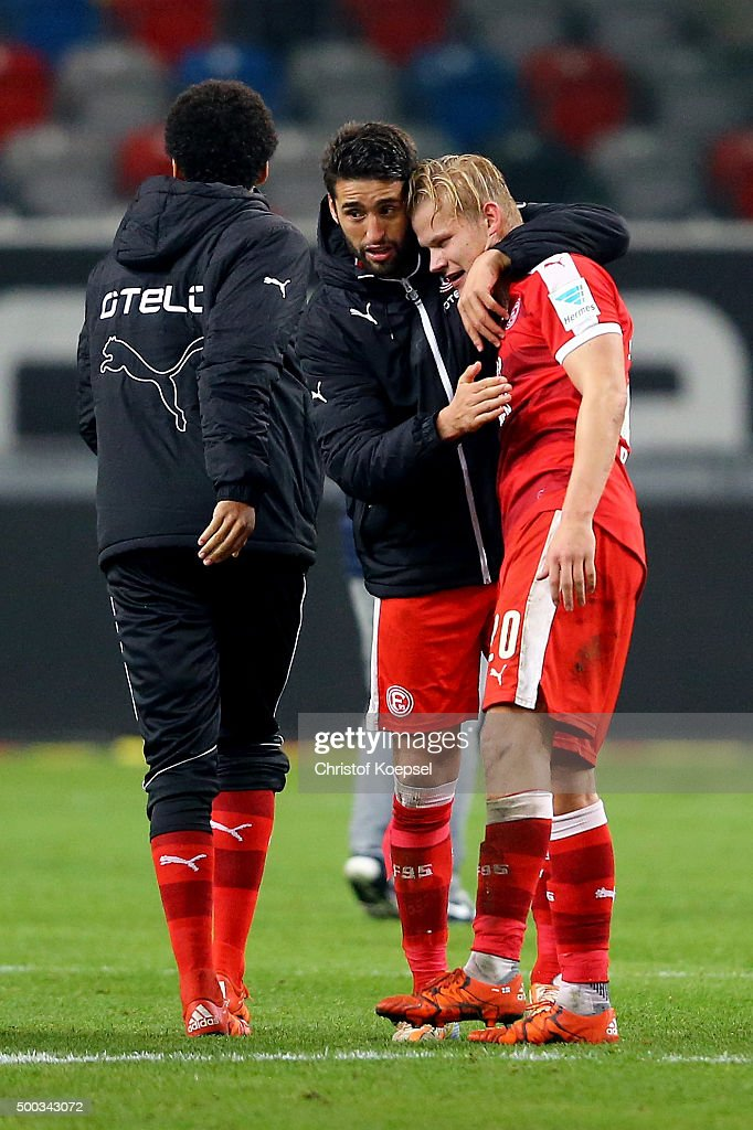 Karim Haggui of Duesseldorf (L) embraces Joel Pohjanpalo of Duesseldorf who scored the decision goal during the Second Bundesliga match between Fortuna Duesseldorf and Eintracht Braunschweig at Esprit-Arena on December 7, 2015 in Duesseldorf, Germany. The match between Duesseldorf and Braunschweig ended 1-0.
