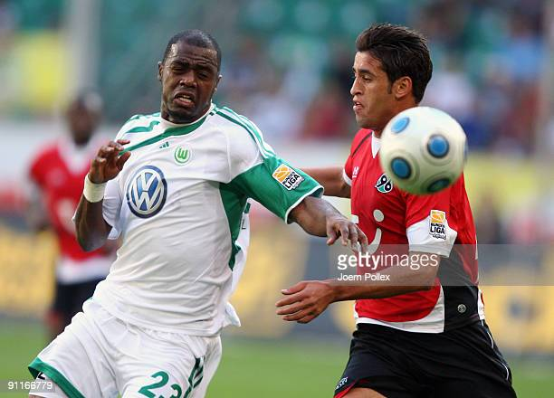 Karim Haggui of Hannover and Grafite of Wolfsburg battle for the ball during the Bundesliga match between VfL Wolfsburg and Hannover 96 at Volkswagen...