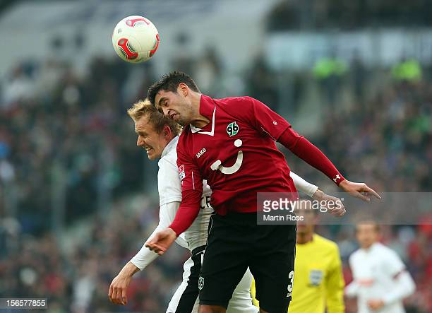 Karim Haggui of Hannover and Jan Rosenthal Freiburg head for the ball during the Bundesliga match between Hannover 96 and SC Freiburg at AWD Arena on...