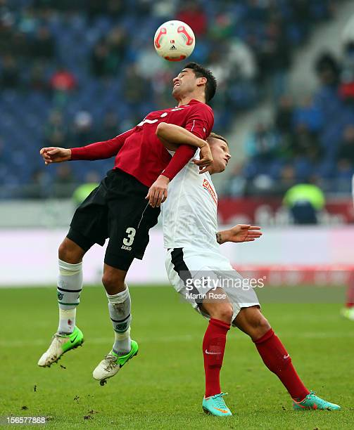 Karim Haggui of Hannover and Jonathan Schmid Freiburg battle for the ball during the Bundesliga match between Hannover 96 and SC Freiburg at AWD...