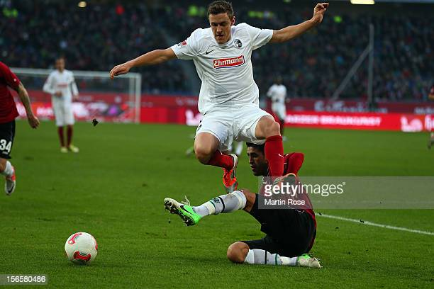 Karim Haggui of Hannover and Max Kruse of Freiburg battle for the ball during the Bundesliga match between Hannover 96 and SC Freiburg at AWD Arena...
