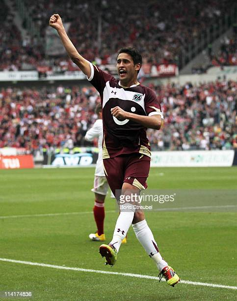 Karim Haggui of Hannover celebrates his team's first goal during the Bundesliga match between Hannover 96 and 1 FC Nuernberg at AWD Arena on May 14...