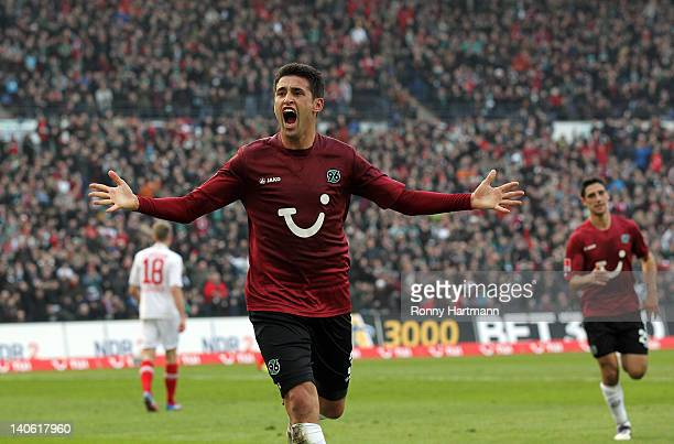 Karim Haggui of Hannover celebrates his teams first goal during the Bundesliga match between Hannover 96 and FC Augsburg at AWD Arena on March 03...