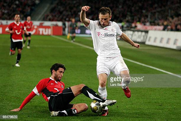 Karim Haggui of Hannover challenges Ivica Olic of Muenchen during the Bundesliga match between Hannover 96 and FC Bayern Muenchen at AWD-Arena on...