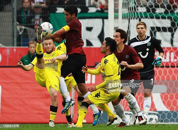 Karim Haggui of Hanover and Jakub Blaszczykowski of Dortmund battle for the ball during the Bundesliga match between Hanover 96 and Borussia Dortmund...