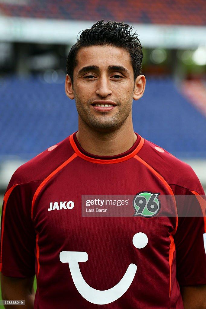 Karim Haggui poses during the Hannover 96 team presentation at HDI Arena on July 11, 2013 in Hanover, Germany.