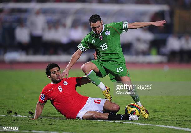 Karim Ky Ziani of Algeria skips through a challenge from Hany M Said of Egypt during the FIFA2010 World Cup qualifying match between Egypt and...