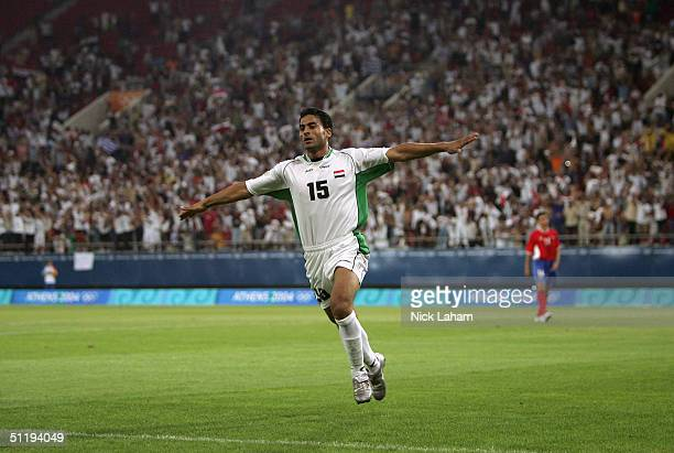 Karim Mahdi of Iraq celebrates scoring a goal in a men's football preliminary match against Costa Rica on August 15 2004 during the Athens 2004...