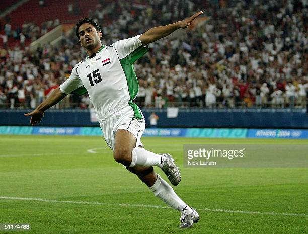 Karim Mahdi of Iraq celebrates scoring Iraq's second goal during the men's football preliminary match on August 15, 2004 during the Athens 2004...