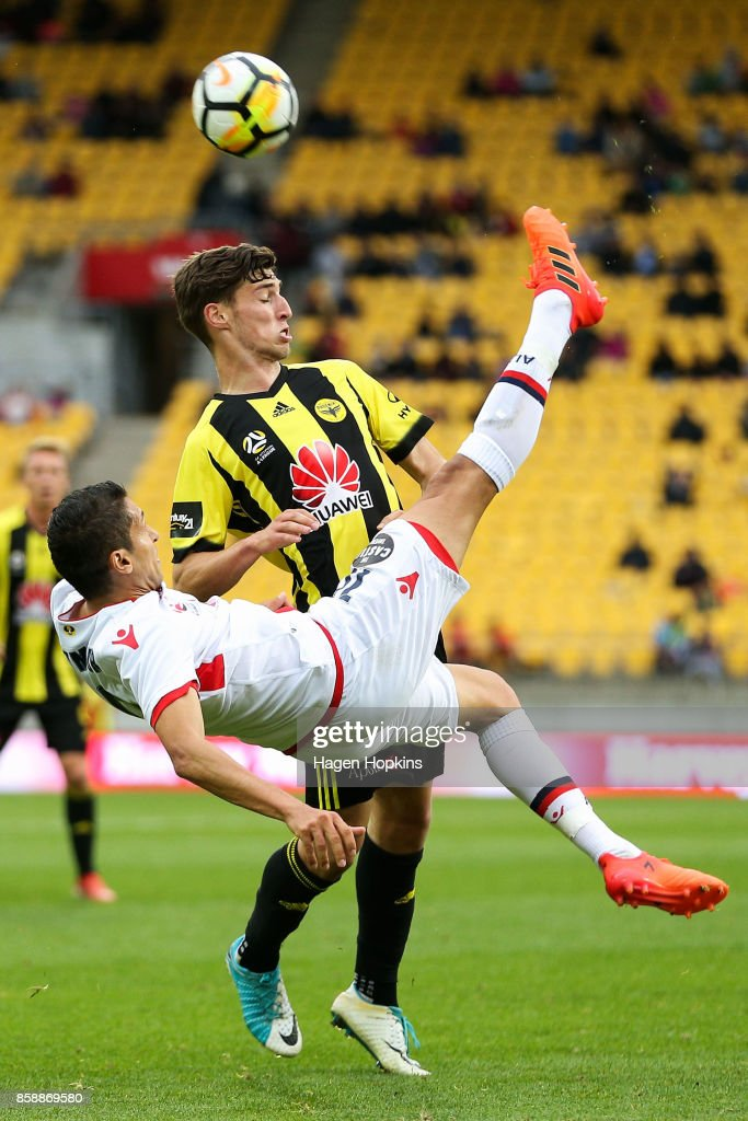 Karim Matmour of Adelaide United performs a bicycle kick in front of Matthew Ridenton of the Phoenix during the round one A-League match between Wellington Phoenix and Adelaide United at Westpac Stadium on October 8, 2017 in Wellington, New Zealand.