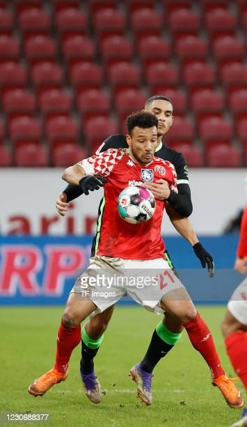 Karim Onisiwo of 1. FSV Mainz 05 and Maxence Lacroix of VfL Wolfsburg during the Bundesliga match between 1. FSV Mainz 05 and VfL Wolfsburg at Opel...